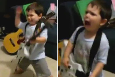 2 years old playing Bulls on Parade on Guitar Hero