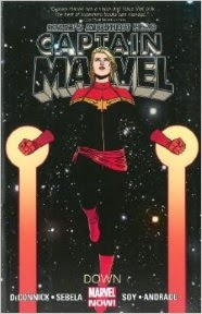 Cover art for Captain Marvel by Kelly Sue Deconnick, featuring a pale-skinned blonde woman in vertical flight.
