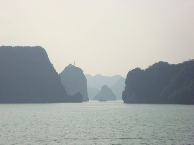 Pagoda over a small island in Halong Bay