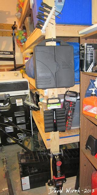 store tools in garage, hooks, shelf, air tools