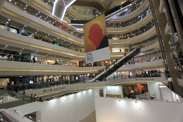 Inside view of Times Square shopping mall with the steep escalator in Causeway Bay, Hong Kong