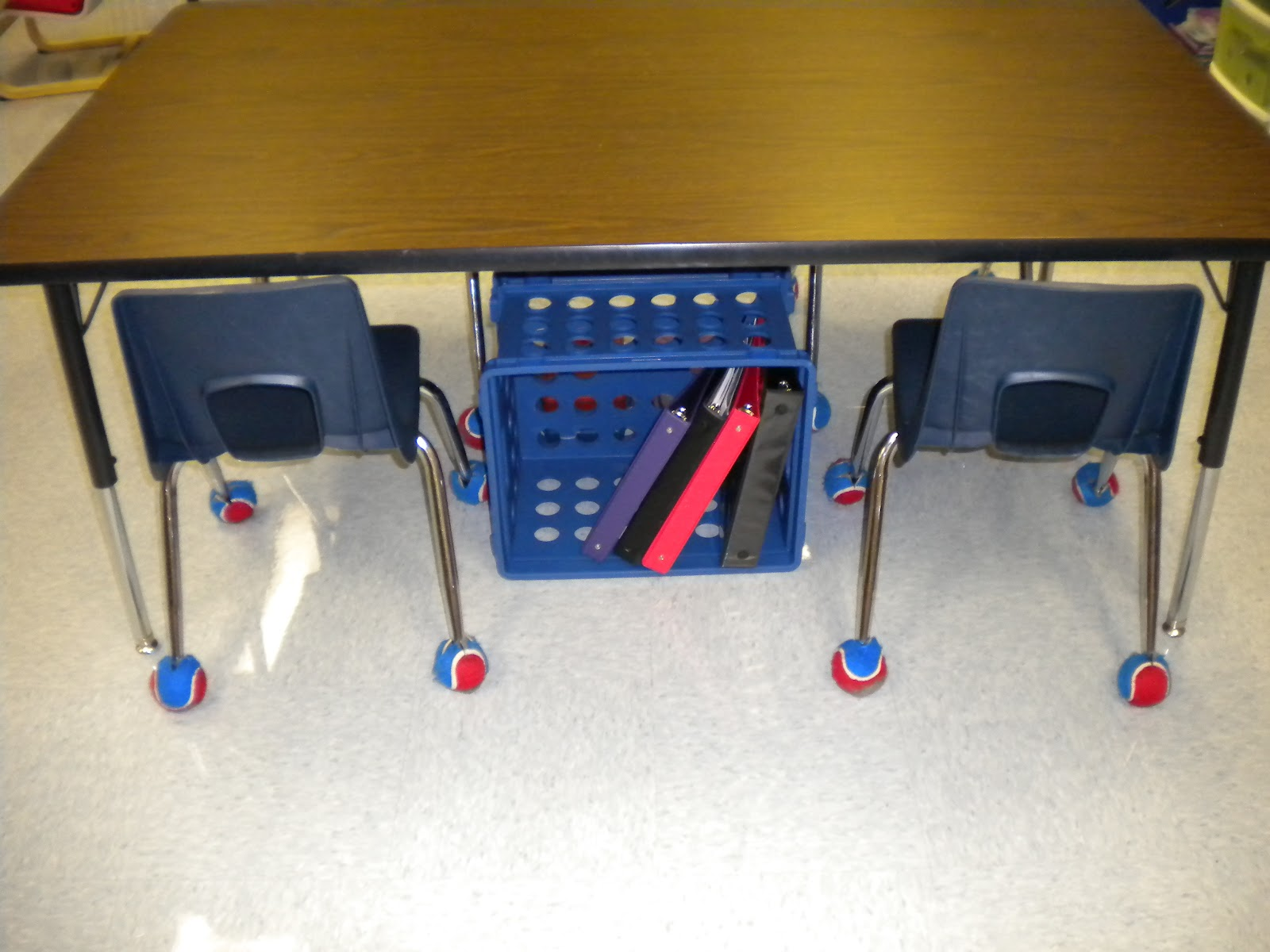 First grade randomness table storage using filing crates for Tables and desks in the classroom