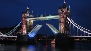 The most interesting fact about Tower Bridge is that it opens for ships with . (openbridge night)