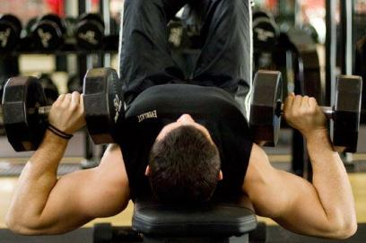 man-dumbbell-pressing - 6 Ways to Make Your Daily Workouts More Interesting