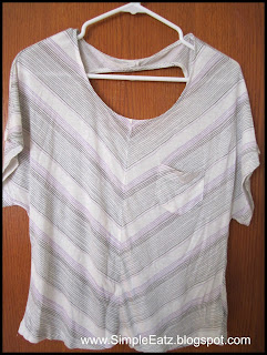 White t-shirt. Flowy sleeves. Circle cut-out on the back. V striked pattern design .