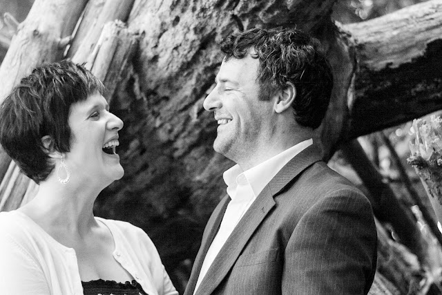 husband and wife laughing at each other