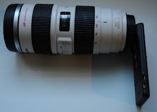 fake telephoto lens coffee mug attached to droid x2 cell phone smart