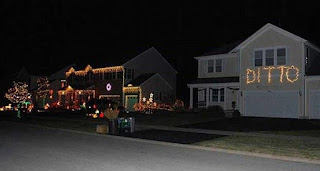 a house decorated with Christmas lights and the neighbors lights say ditto, ditto christmas lights