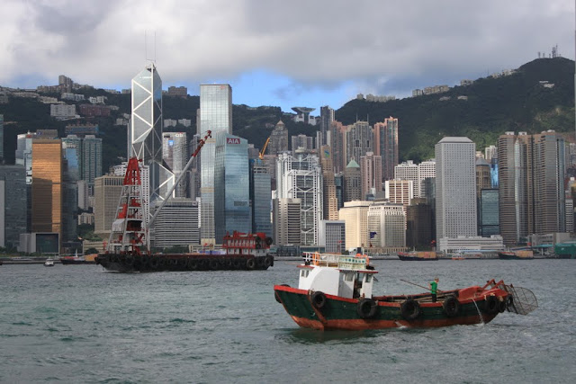 Fishing boat along Victoria Harbour in Hong Kong