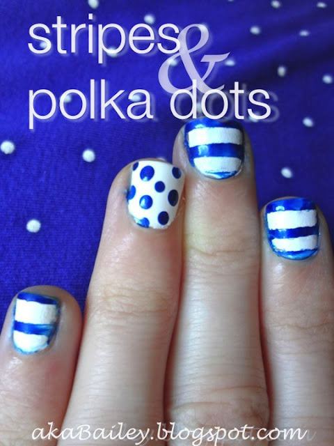 white nails with blue stripes and blue polka dots