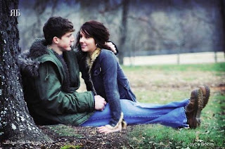 couple sitting under tree cover photo for facebook