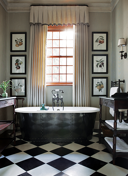 black and white checkerboard floor bathroom with free standing tub