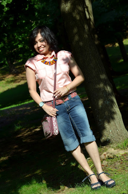 outfit post with denim capri, summer outfit, Levi's capri,Indian fashion blogger, New England fashion blogger, animal print wedge, nine west bag, lane bryant necklace, B K Market shoes