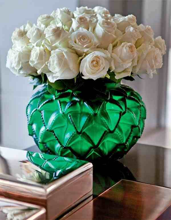 Beautiful white rose flowers in a green vase