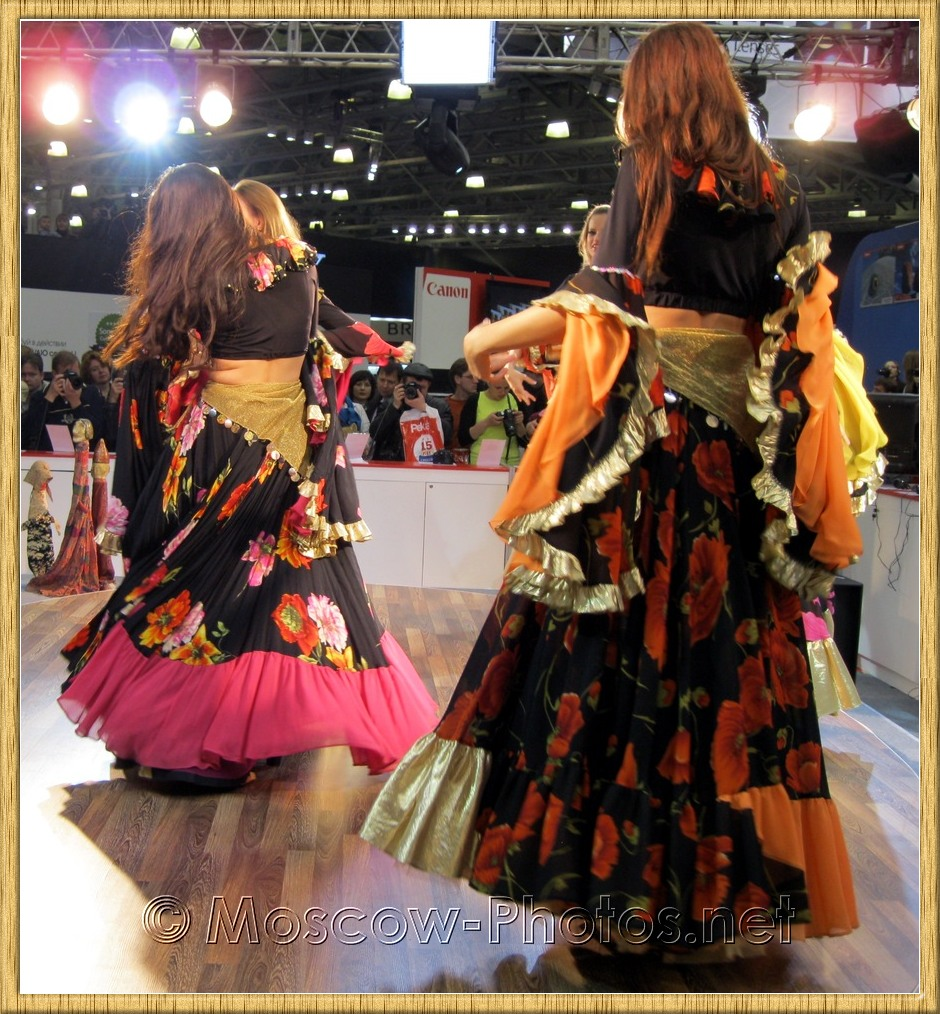 Dancing girls in colorful dresses