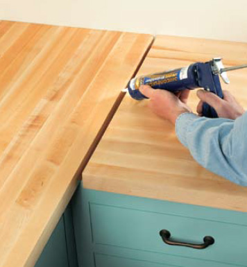 joints between countertop sections. Lay the two sections of countertop ...