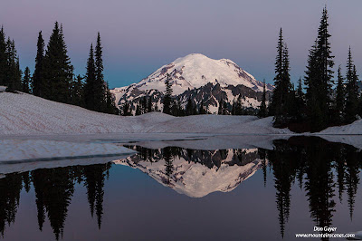 Mount Rainier reflected in the still water of Upper Tipsoo Lake, Mount Rainier National Park, Cascade range, Washington, USA.