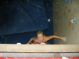 female youth climber bouldering