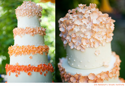 white wedding cake with orange hydrangeas
