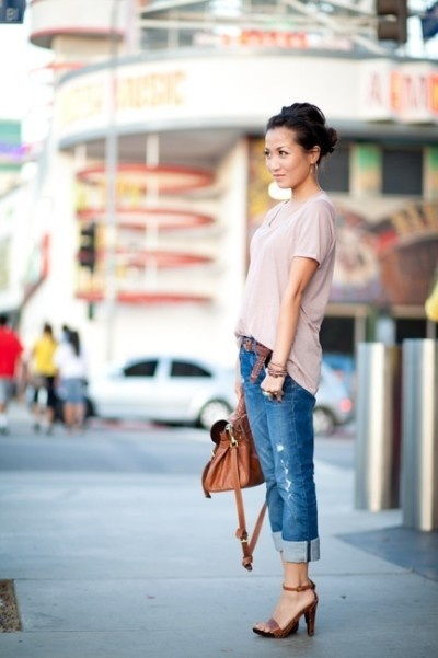 A super feminine hairstyle and flowy top in contrast to the jeans
