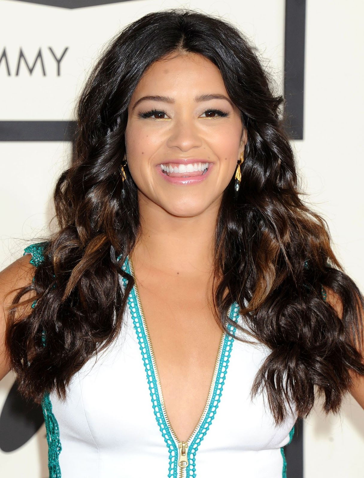 Gina Rodriguez is gorgeous in a white and teal gown at the 2015 Grammy Awards in LA