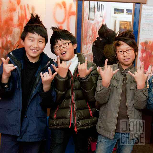 Korean boys posing with their new hairstyles on a school field trip to an English Village in South Korea.