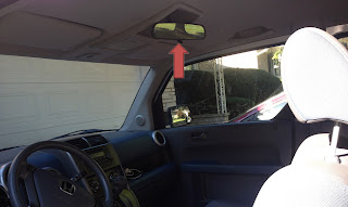 Rear view mirror blocking view for tall people so raise it up