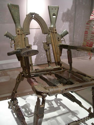 chair made out of guns weapons art