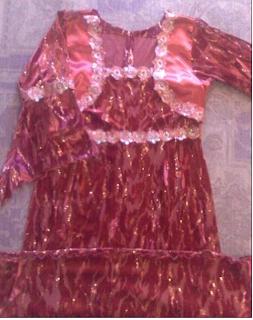 http://www.almaraaworld.com/2013/11/Dresses-amaranth-Balbolieo-House.html