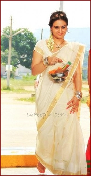 Actress Aksha walking in white traditional saree