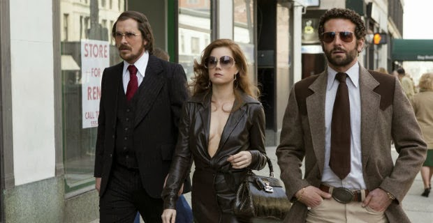 "Christian Bale, Amy Adams, and Bradley Cooper in ""American Hustle"""