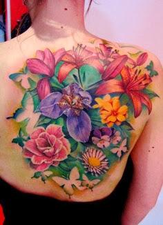 Colorful garden flower tattoo on full back