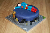 Child's Superman cake - Superman character flying over cityscape