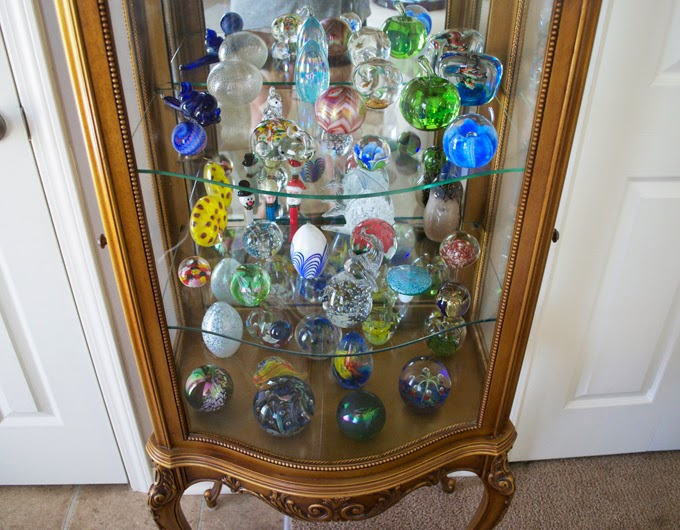 glass-cabinet-paper-weights-gold