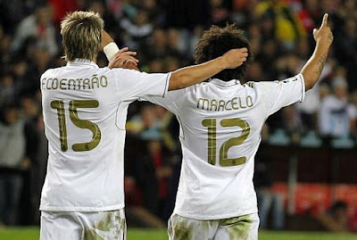 Fabio Coentrao and Marcelo with the Real Madrid jersey