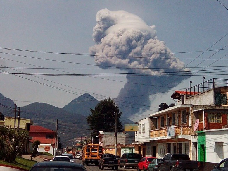 Guatemalan volcanoes Santiaguito and Fuego erupt sending ash plumes kilometres into the sky