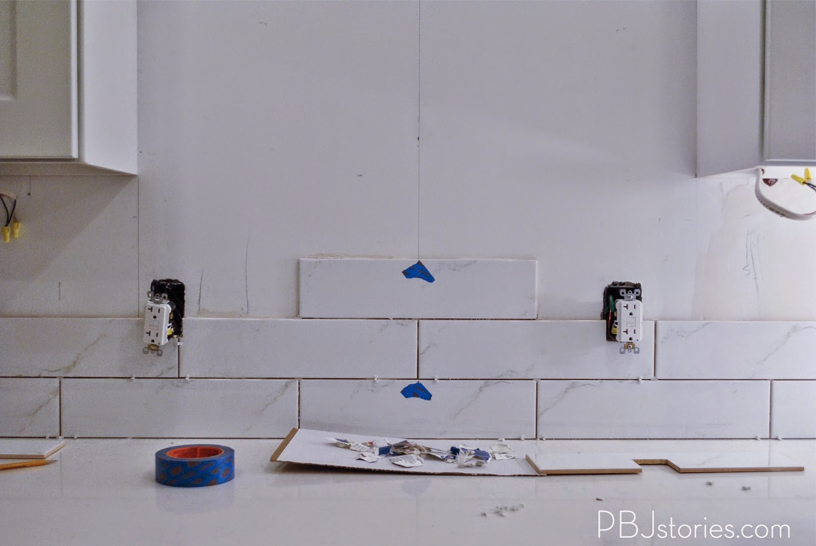 Pbjstories installing subway tile for kitchen backsplash pbjreno similar to how we cut the outlet tiles we had to cut out the areas for the pendant lights it was a little more difficult since its a curved area dailygadgetfo Images