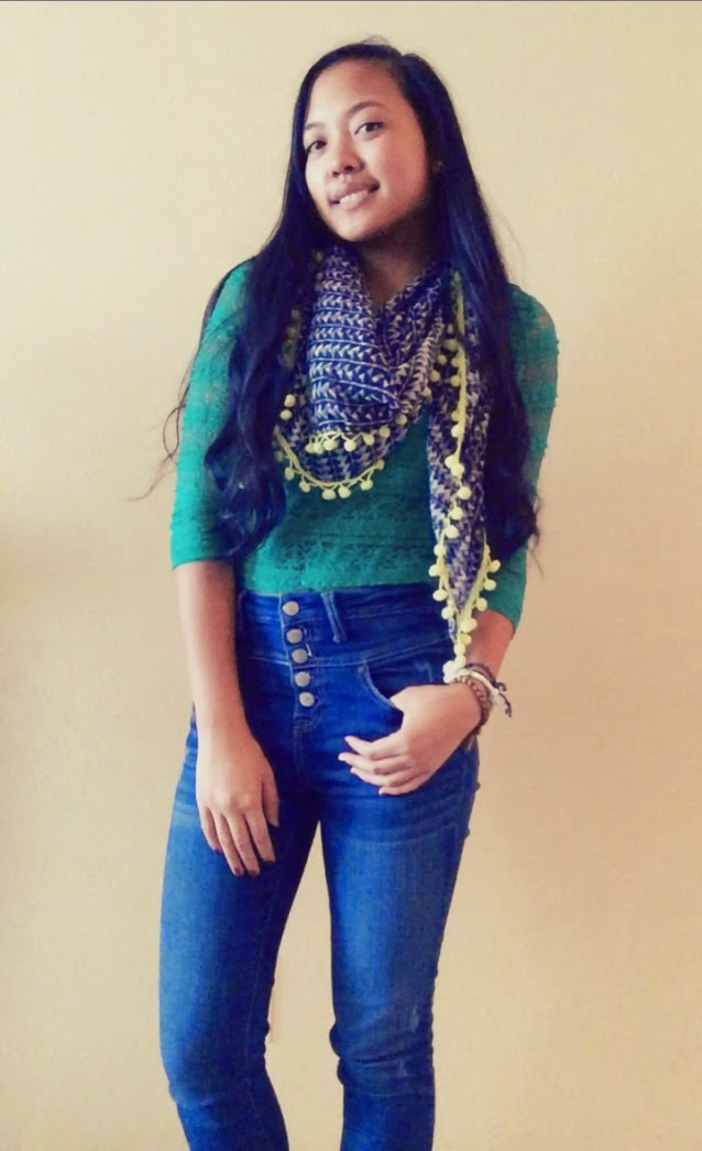 green lace crop top and high waisted jeans