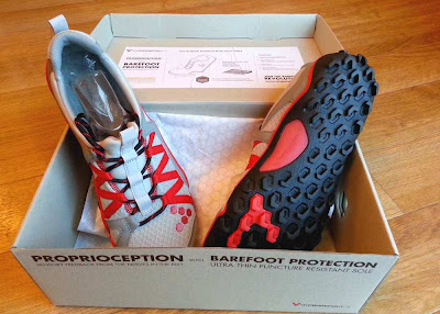 The Vivobarefoot Breatho Trail shoes in the box