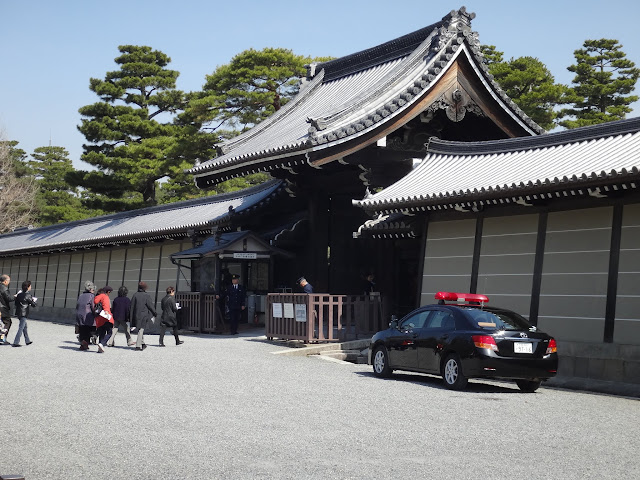 Queuing up and waiting for the guided tour by the Imperial Household Agency at the main entrance of Kyoto Imperial Palace (Kyoto Gosho) in Kyoto, Japan