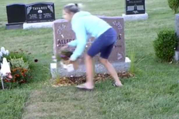 A Yet unidentified woman was captured by a hidden camera installed near the grave was seen stealing flowers and stuff from the grandmother's grave