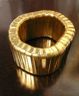 Shiny, golden INTIQ bangle.
