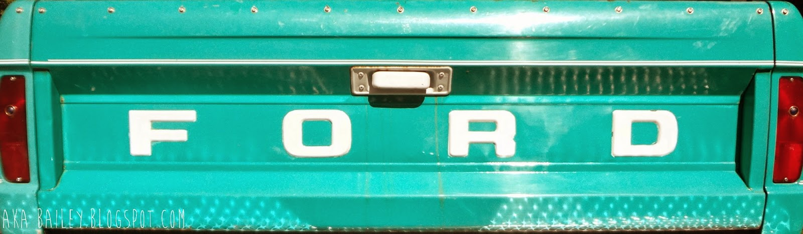 Tailgate of old turquoise Ford truck