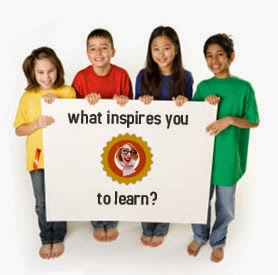 Students holding a sign asking what inspires you to learn