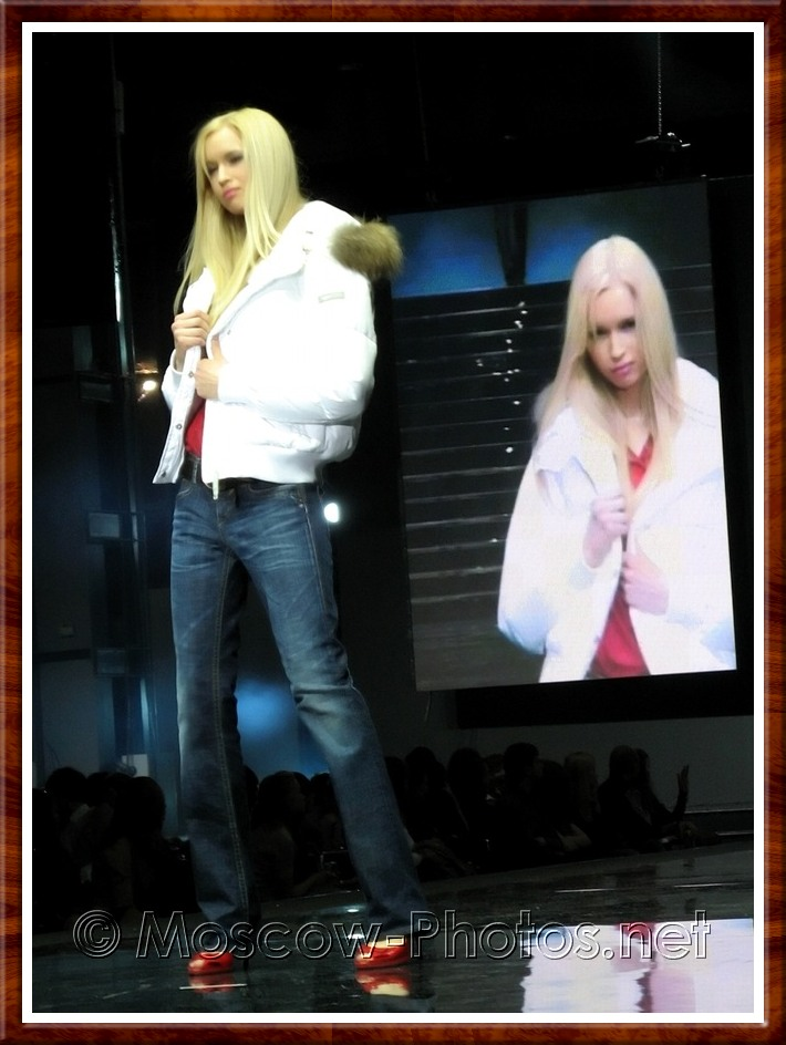 Blonde model in white jacket and jeans on Moscow Fashion Expo - 2007