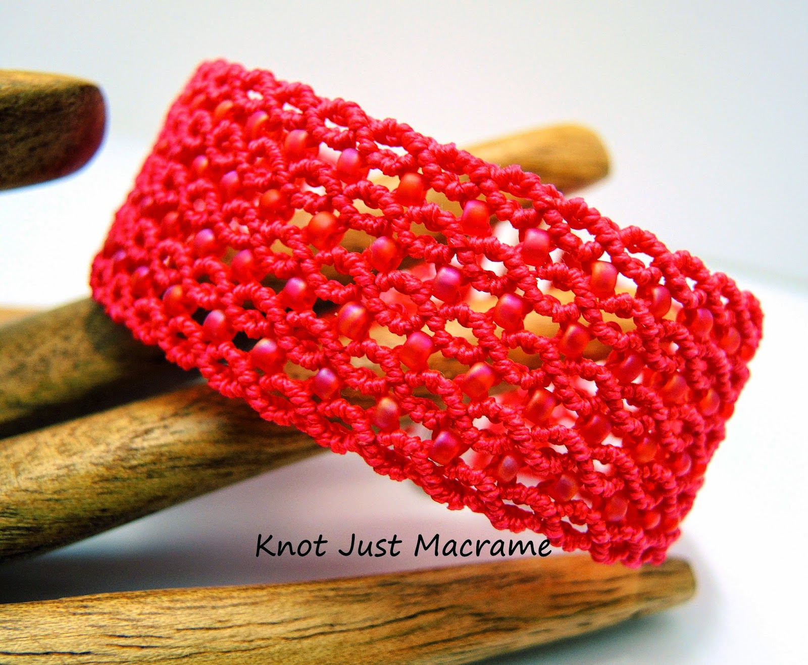 Micro macrame cuff bracelet in red by Sherri Stokey.