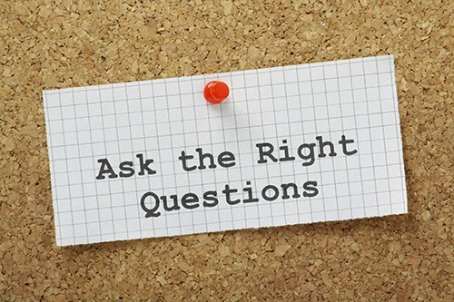image of cork bulletin board with post it that reads: Ask the right questions.
