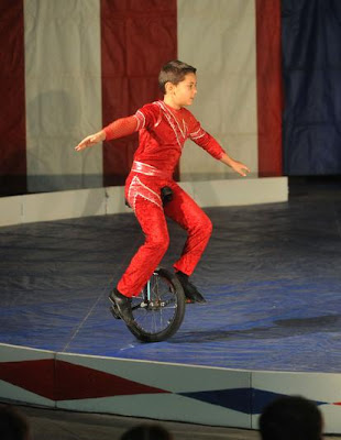 on a unicycle Midget
