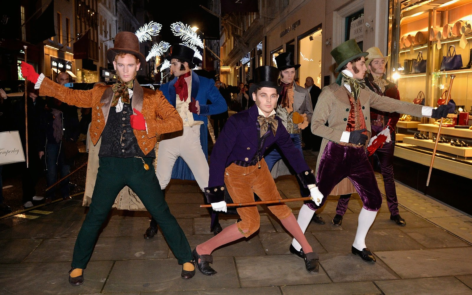 "Six dapper young men re-enacting the famous 18th century ""Bond Street Roll"" in celebration of Bond Street's spectacular Christmas illuminations on November 13, 2014 in London, England. The new West End Company's Bond Street Development Group are responsible for the £1 million Bond Street festive illumination scheme which has been dedicated to these ""gentleman"" of the era. Photo by Anthony Harvey/Getty Images for Bond Street Development Group"