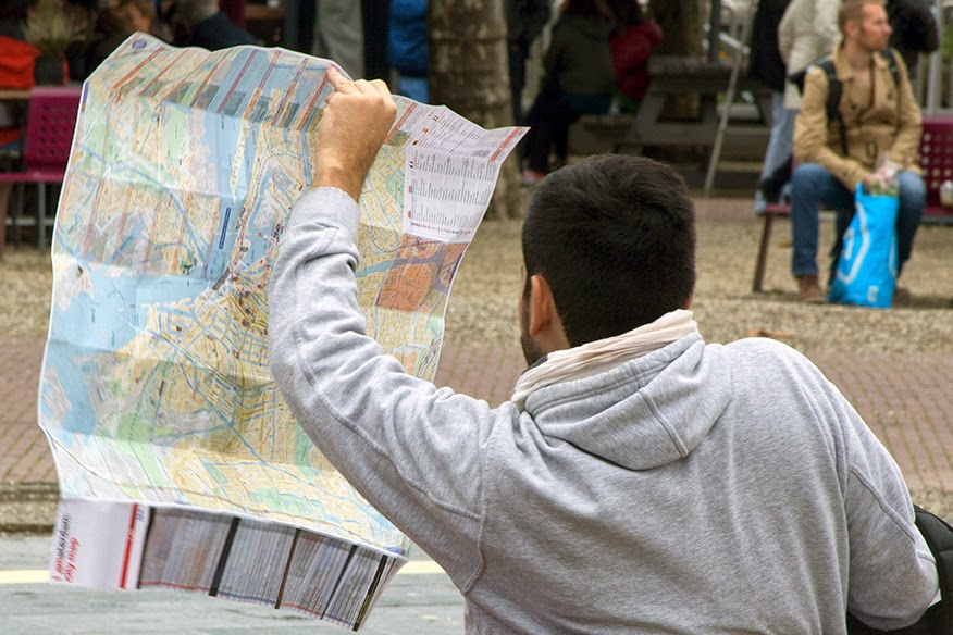 young guy with map